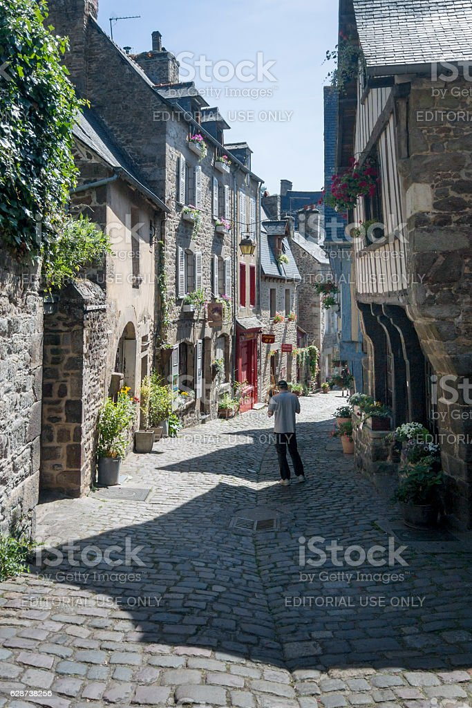 Medieval Cobbled Street in Dinan, Brittany, France stock photo
