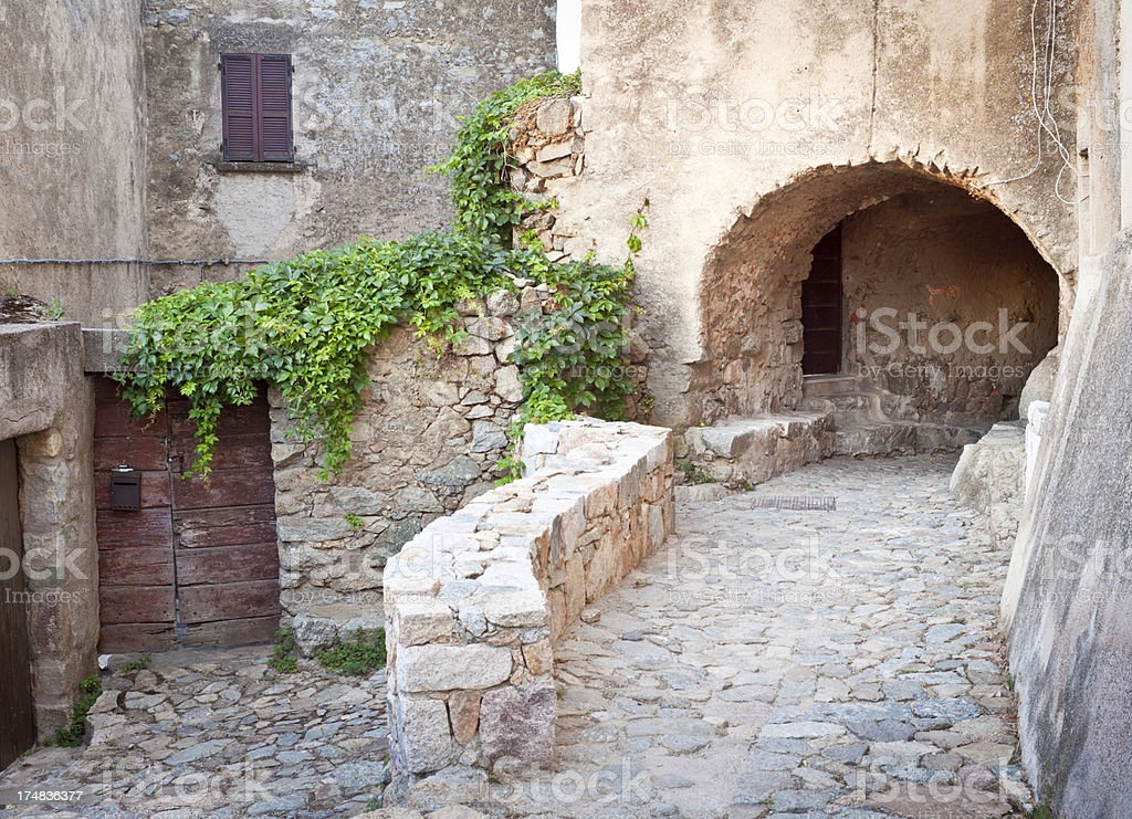 Medieval Cobblestone Alley With Facade and Vault royalty-free stock photo
