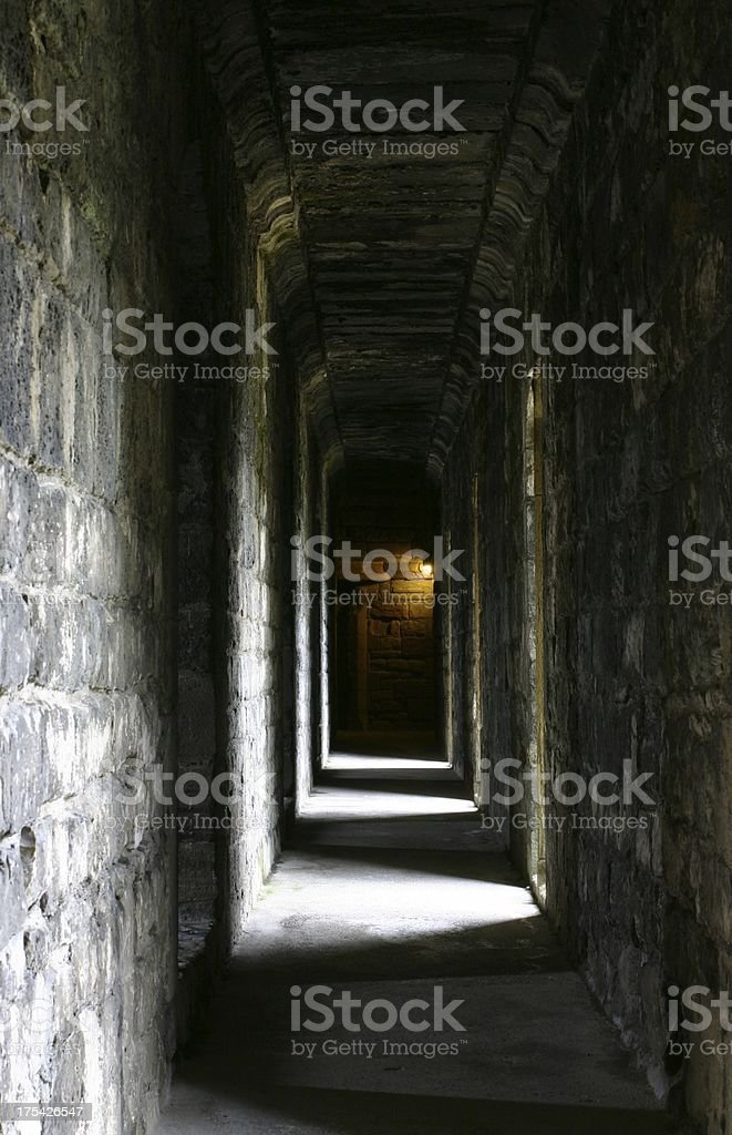 medieval corridor leading to the dungeon royalty-free stock photo