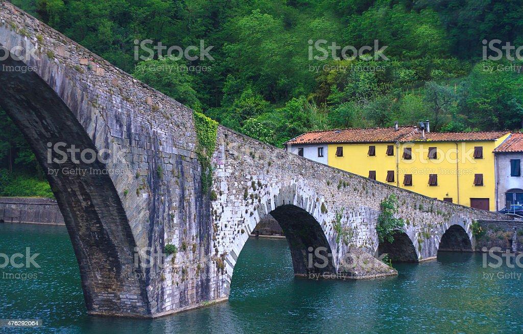 Medieval 'Devil's Bridge' over Serchio River near Lucca, Tuscany, Italy stock photo