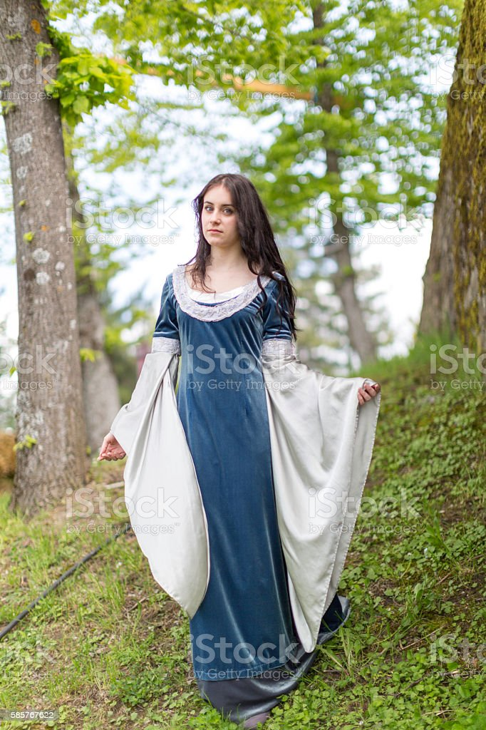 Medieval dress on young girl model with black hair stock photo