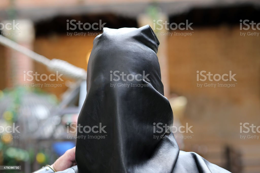 medieval EXECUTIONER with the black cap on head stock photo