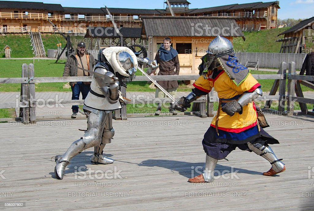 Medieval fights. Swordfight of knights in armor. stock photo