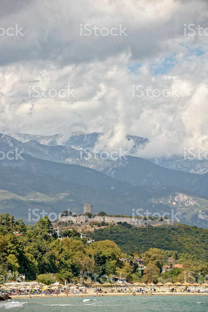 Medieval fortress and resort beach near Platamonas in Greece stock photo