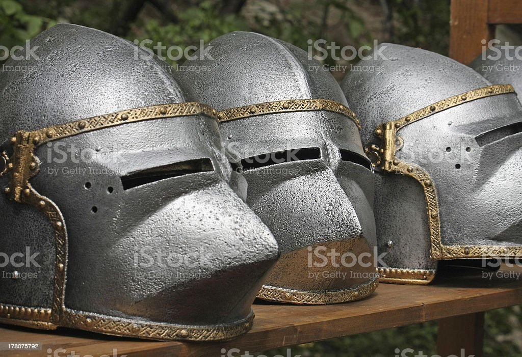medieval helmets of ancient a mighty iron armor royalty-free stock photo
