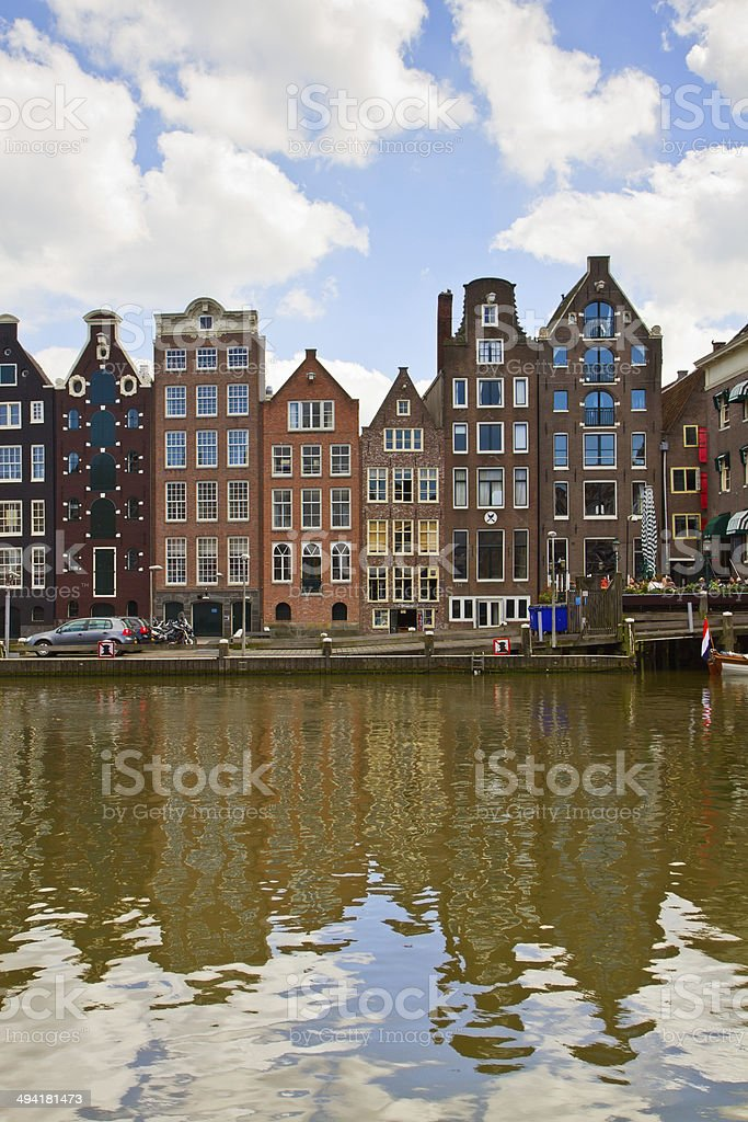 medieval houses over canal water in Amsterdam royalty-free stock photo