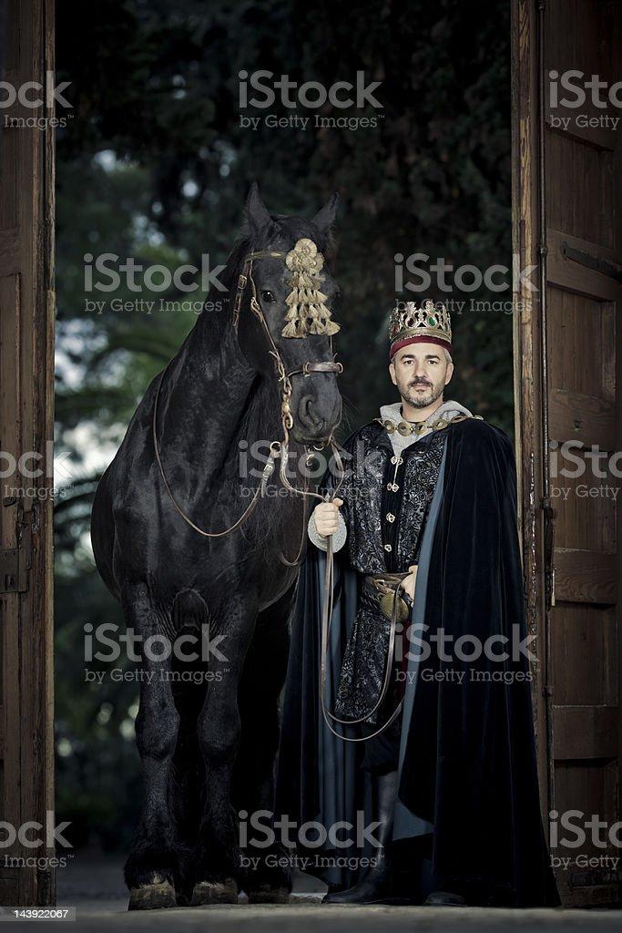 medieval king with black stallion stock photo