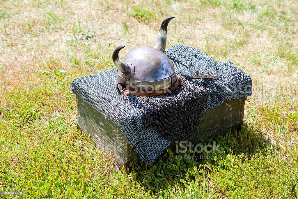 Medieval knight armor with helmet and chain mail stock photo