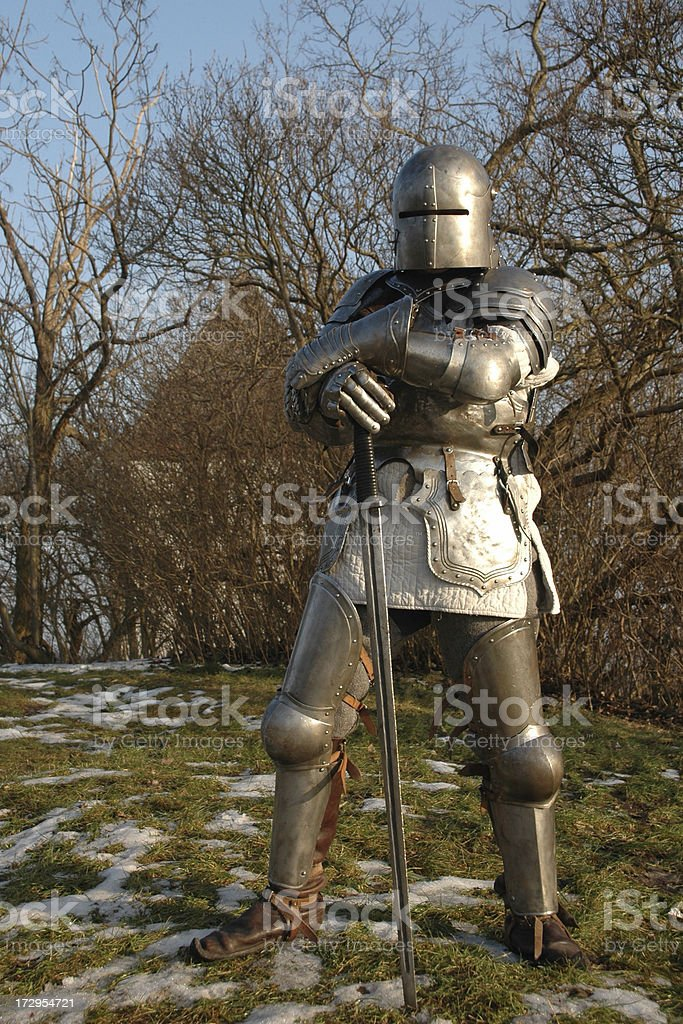 medieval knight based on his sword royalty-free stock photo