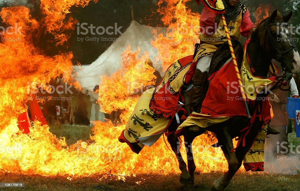 Medieval Knight Horse Jumping Through Ring of Fire royalty-free stock photo