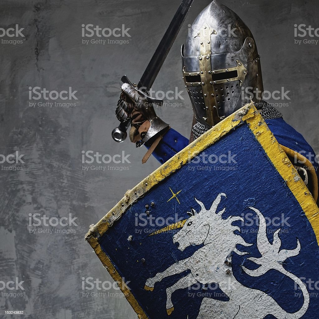 Medieval knight in attack position. stock photo