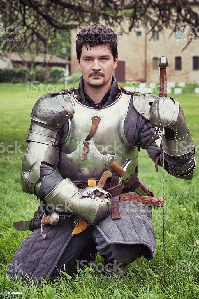 Medieval Knight Kneeling stock photo