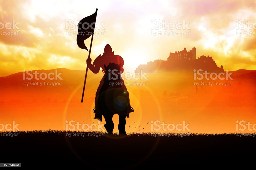 Medieval knight on horse carrying a flag stock photo
