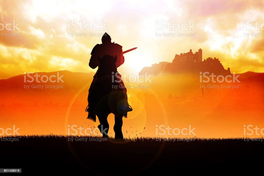 Medieval knight on horse carrying a lance stock photo