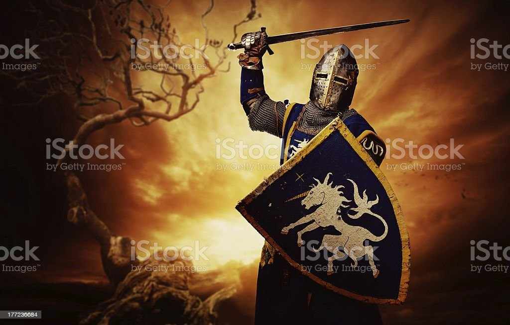 Medieval knight over stormy sky. stock photo