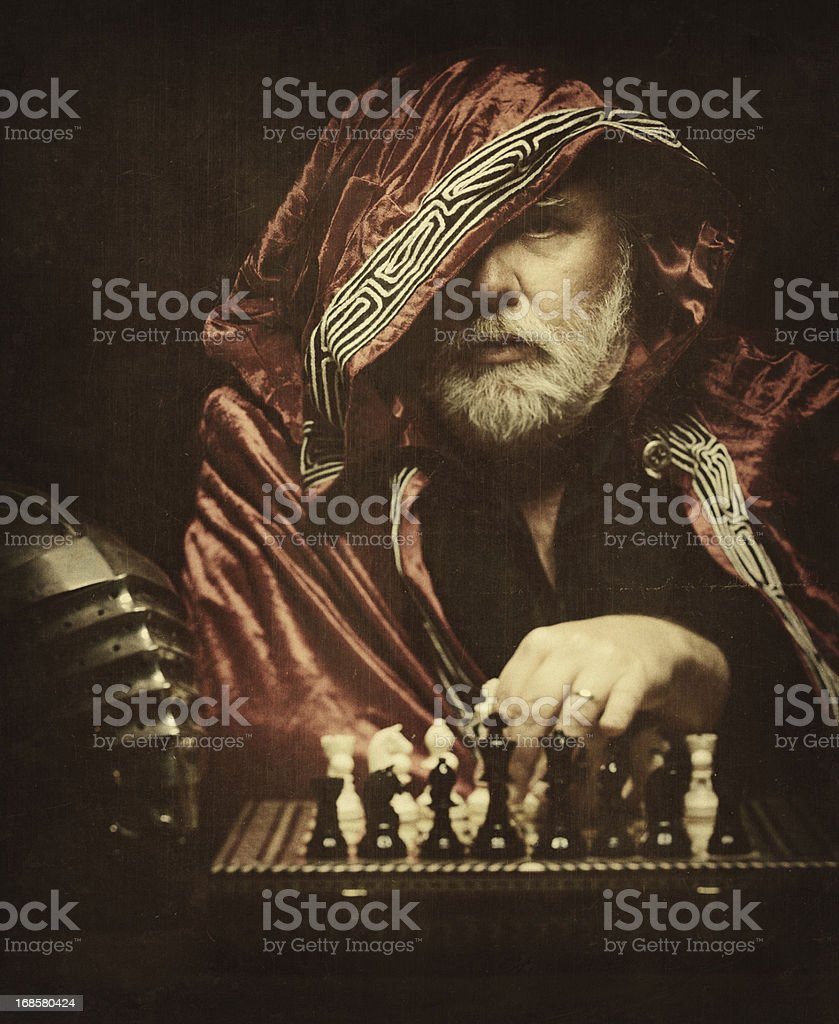 medieval knight playing chess stock photo