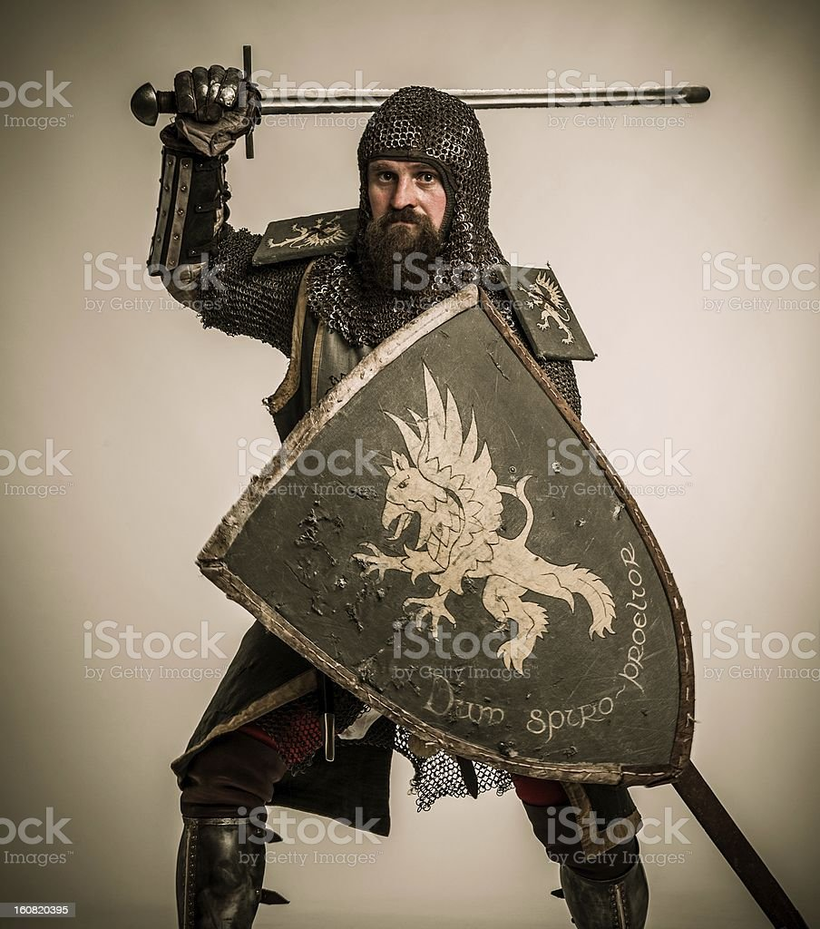 Medieval knight with sword and shield stock photo