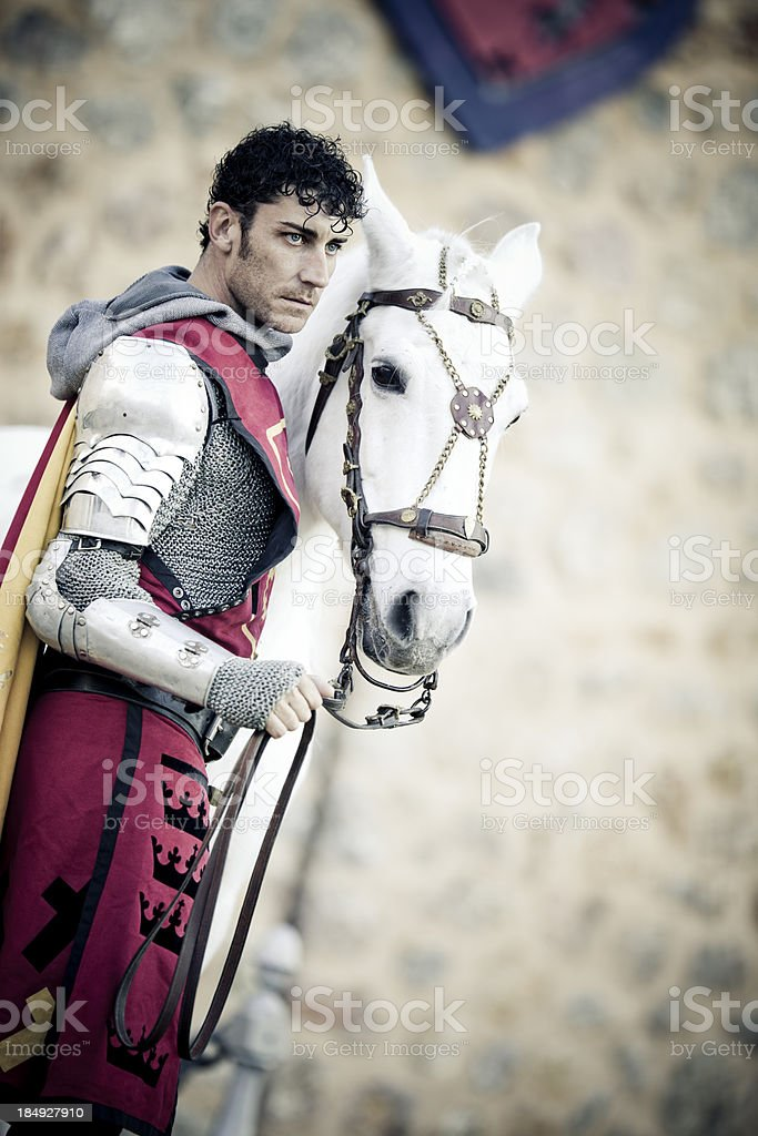 medieval knight with white stallion royalty-free stock photo