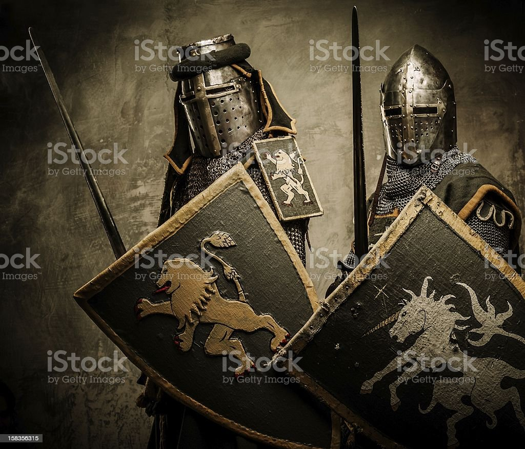 Medieval knights on grey background stock photo