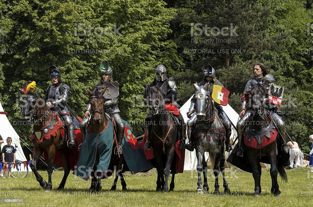 5 medieval knights on horsebacks royalty-free stock photo