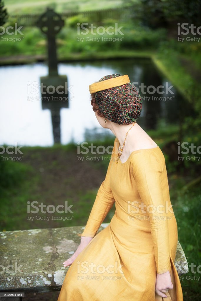 Medieval lady in holy Celtic place stock photo