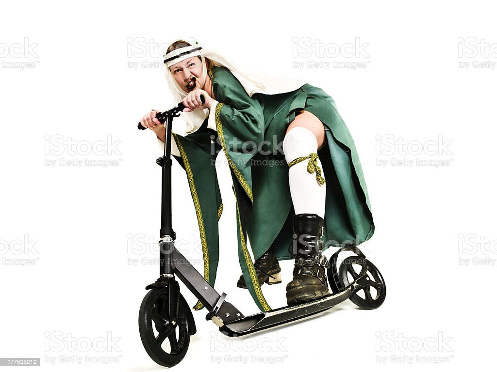 medieval lady with modern scooter royalty-free stock photo