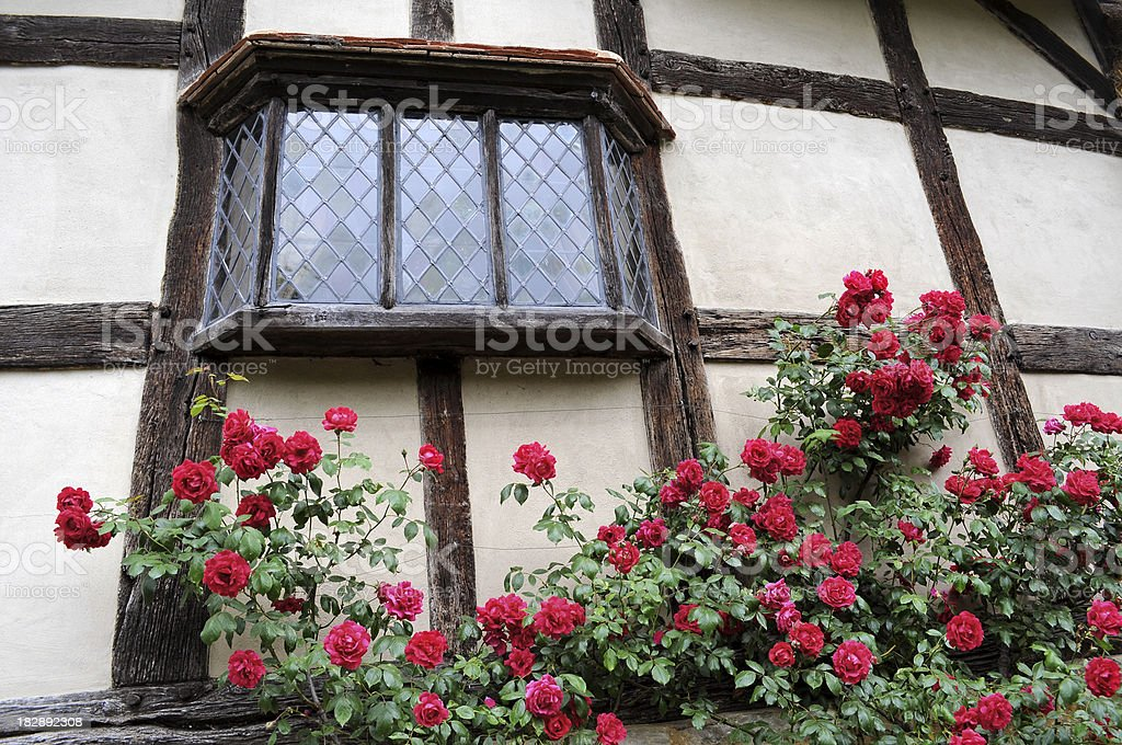 Medieval leaded lights glass window stock photo
