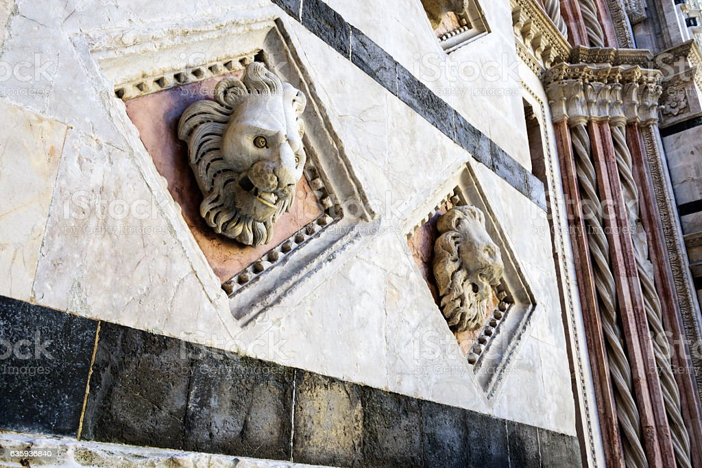 Medieval lion heads, Siena Cathedral, Italy stock photo