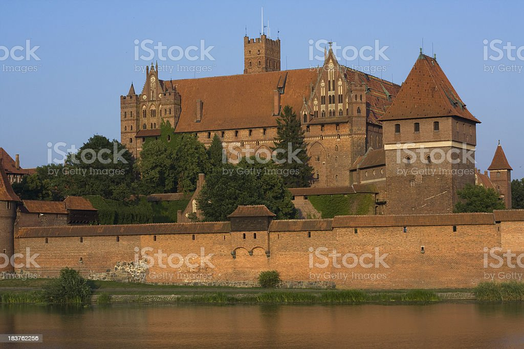 Medieval Malbork castle on the river Nogat, Poland stock photo