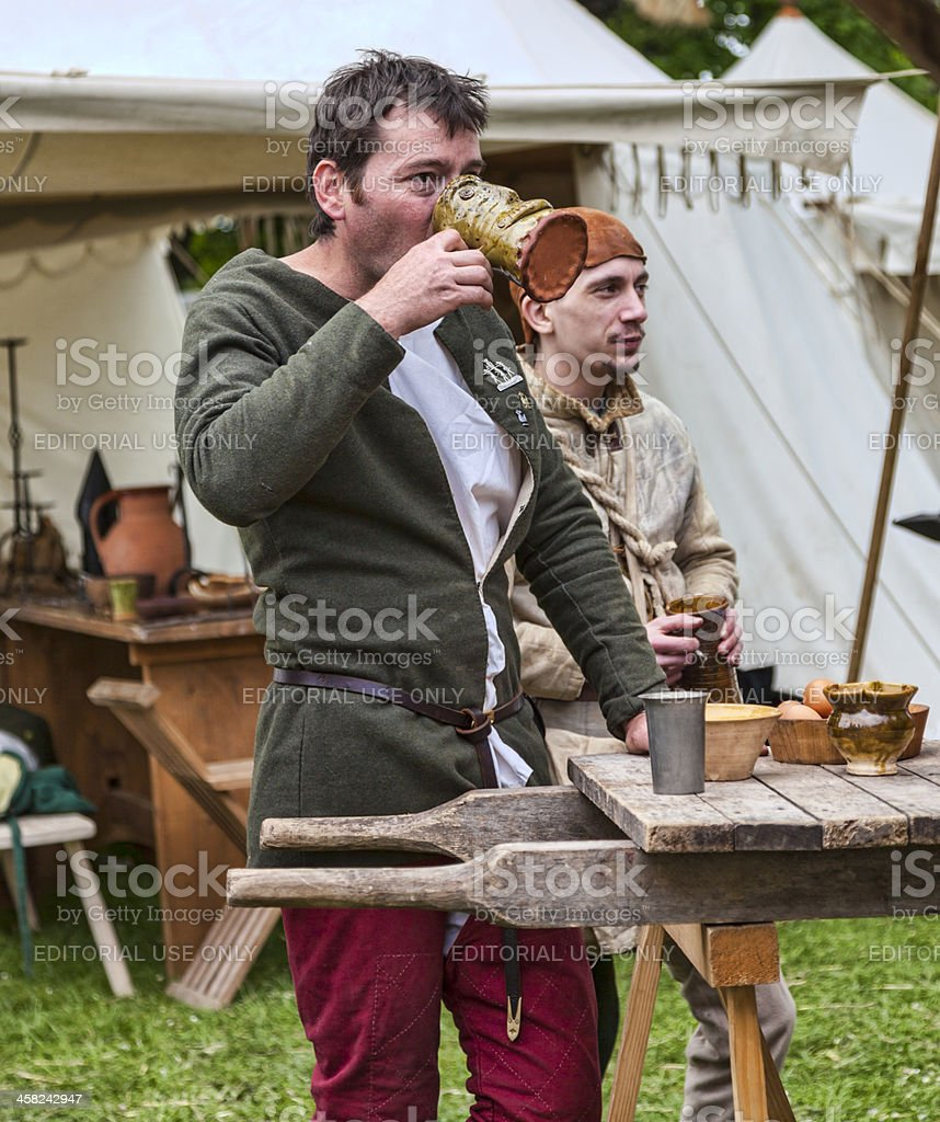 Medieval Man Drinking Wine stock photo