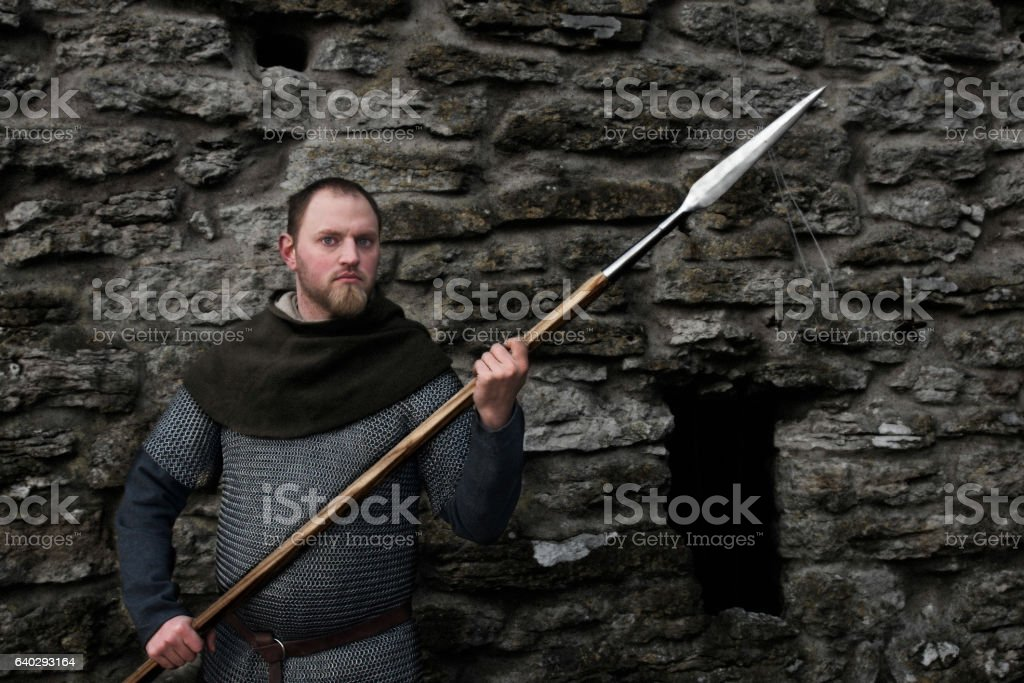 Medieval man holding pointed weapon stock photo