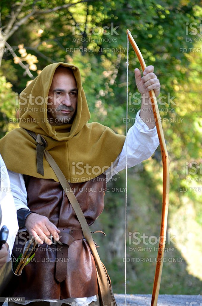medieval man with arch stock photo
