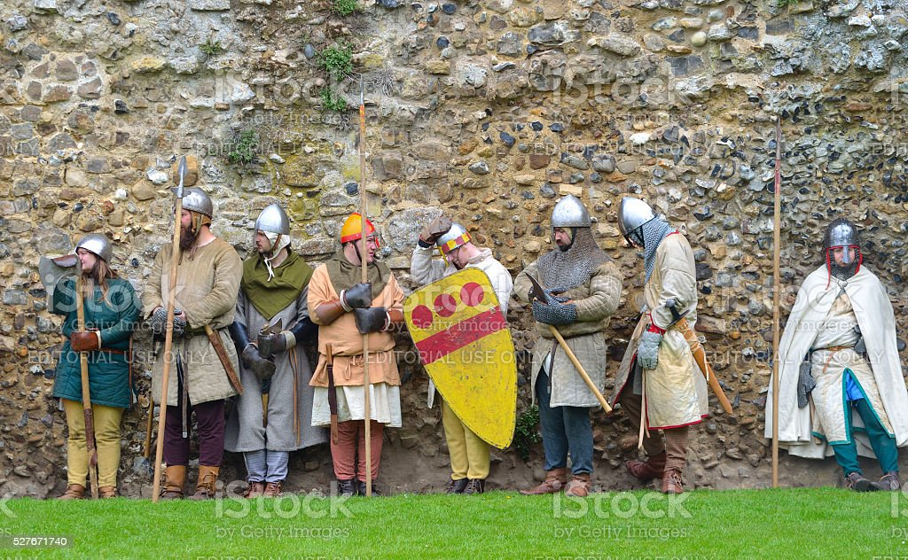 Medieval men at arms against old wall. stock photo