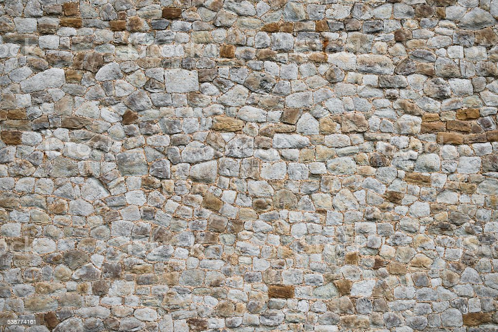 Medieval old wall texture and background unique stone exterior stock photo