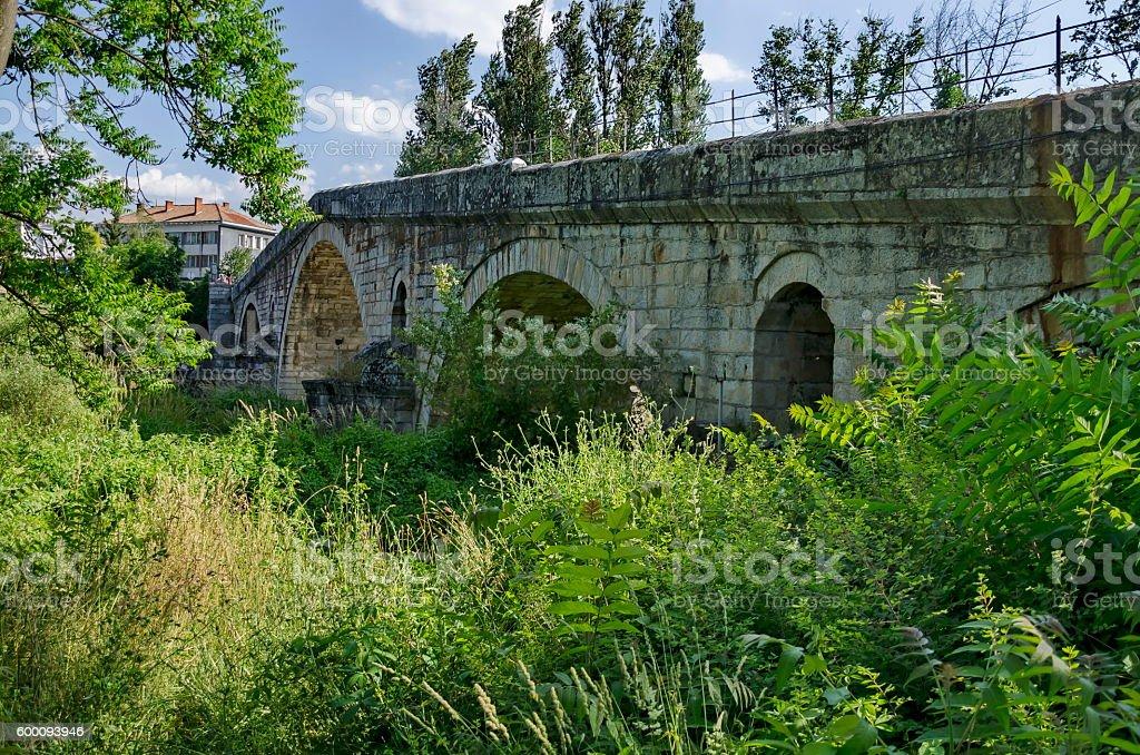 Medieval one hundred meter long stone Kadin bridge stock photo