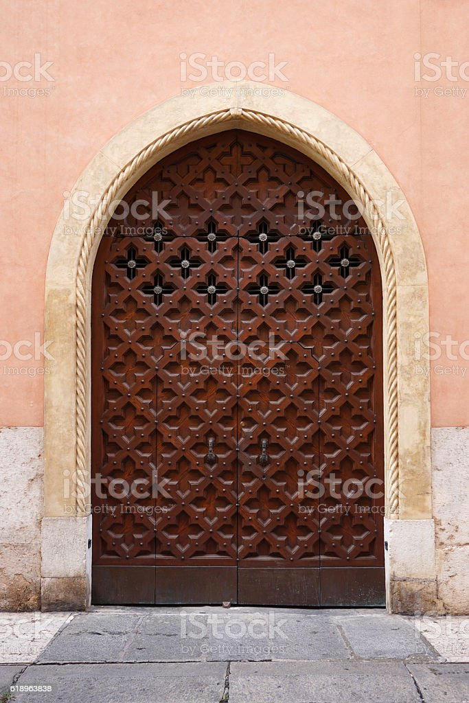 Medieval ornate carved wooden doors in Verona, Italy stock photo