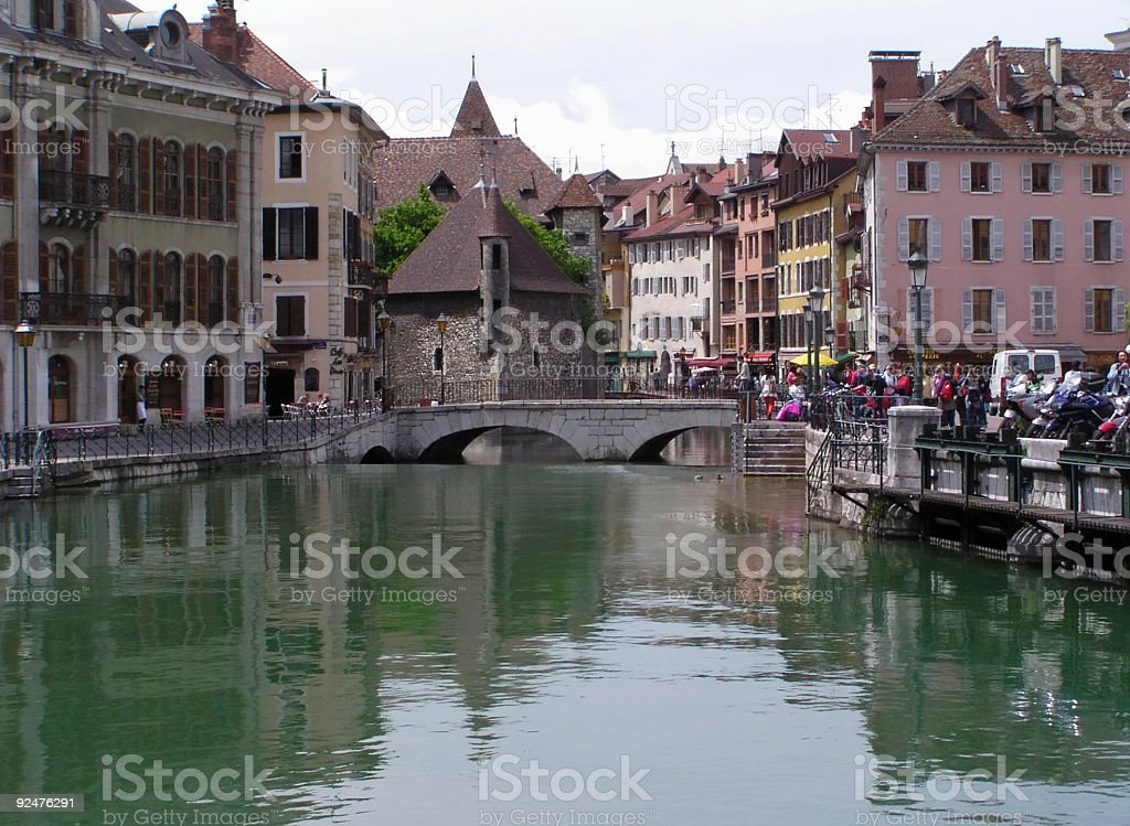 Medieval palace 1 and tourists - Annecy stock photo