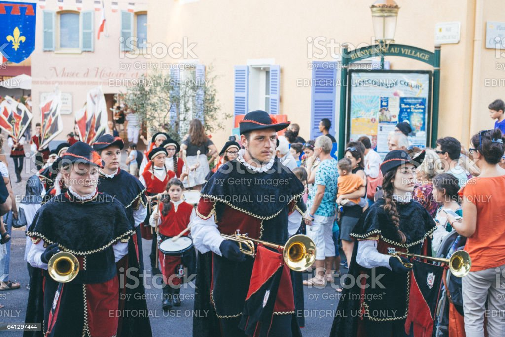 Medieval Parade, enthusiasts, dressed in colorful costumes stock photo