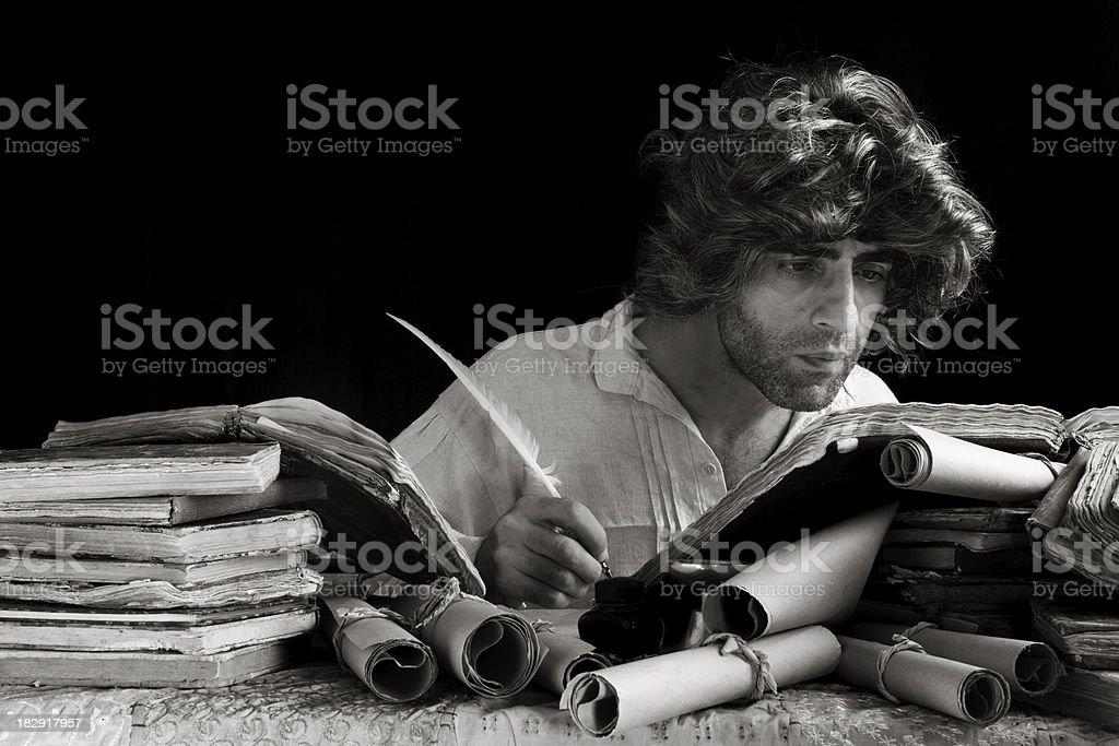 Medieval philosopher writing stock photo