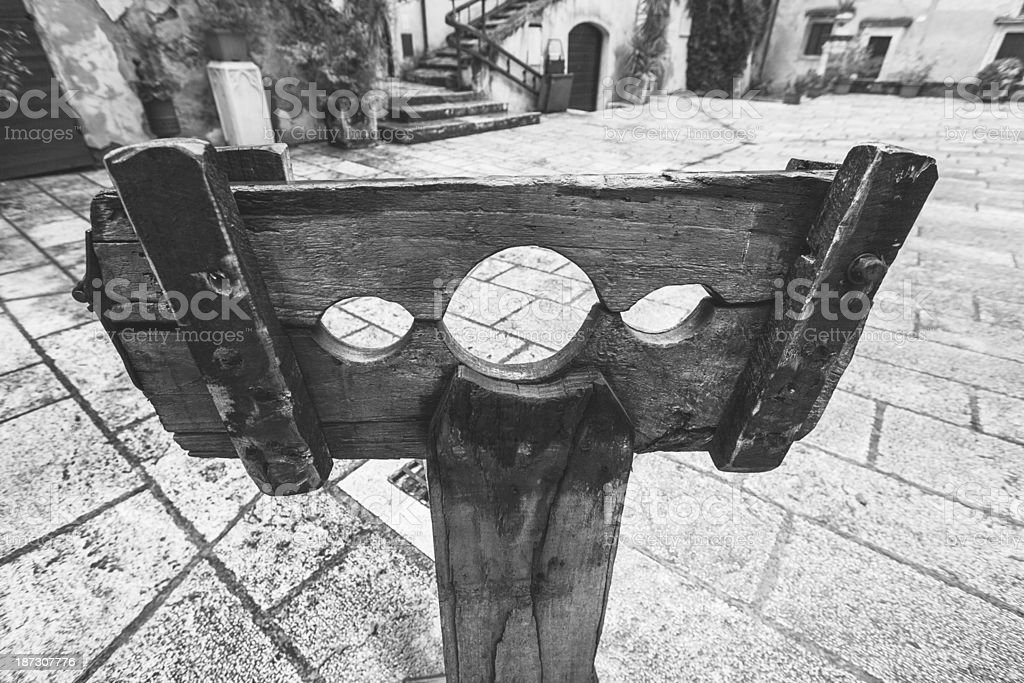 Medieval Pillory in a Village Square stock photo