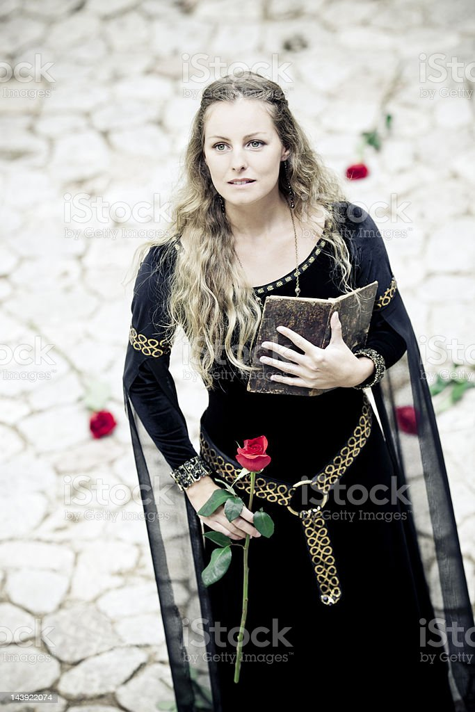 medieval princess with old book royalty-free stock photo