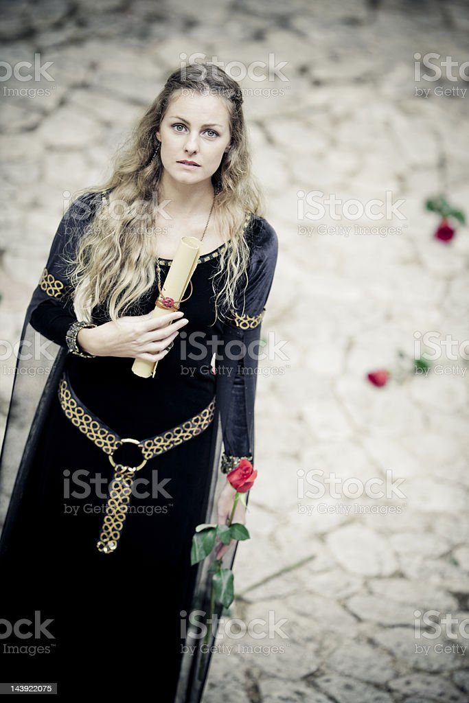 medieval princess with old letter and rose stock photo