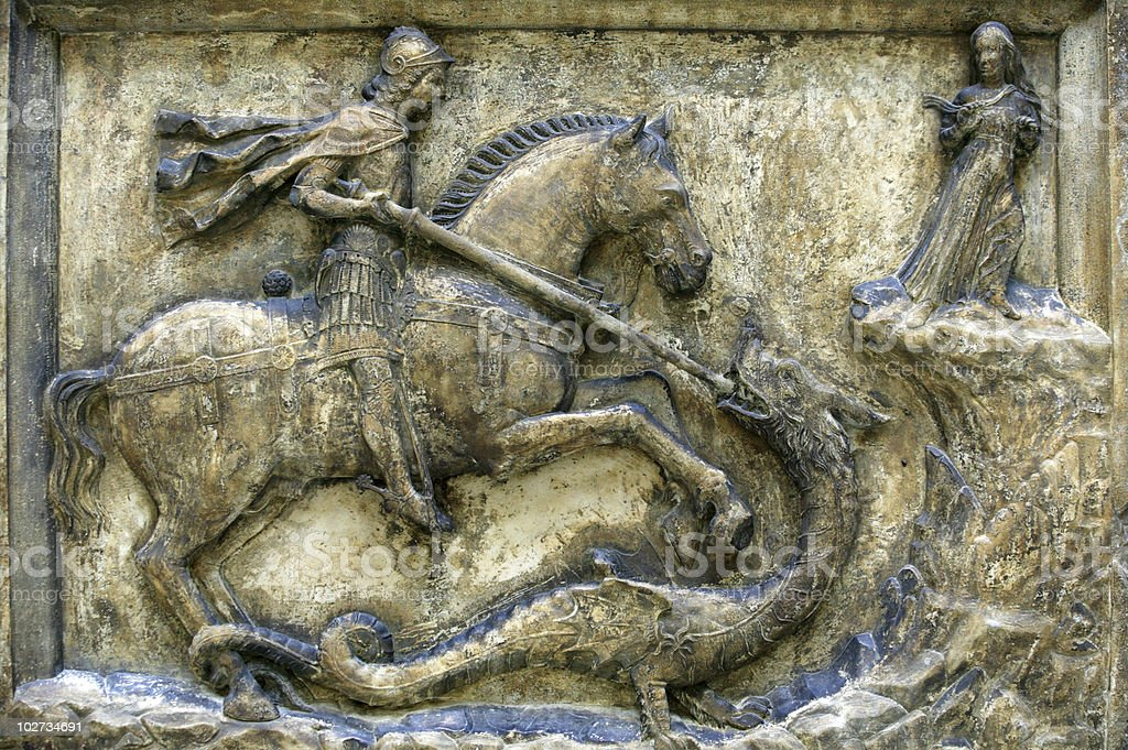 Medieval Relief Of St George And The Dragon stock photo