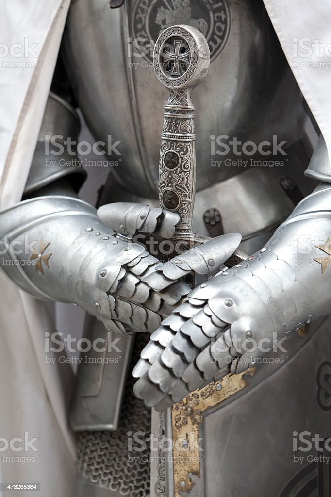 A medieval set of armor and weapons on a knight stock photo