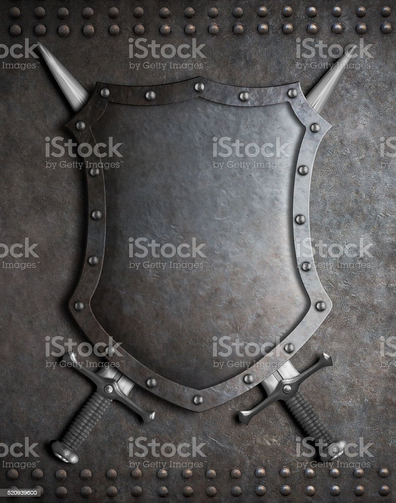 medieval shield with two crossed swords over armour background stock photo