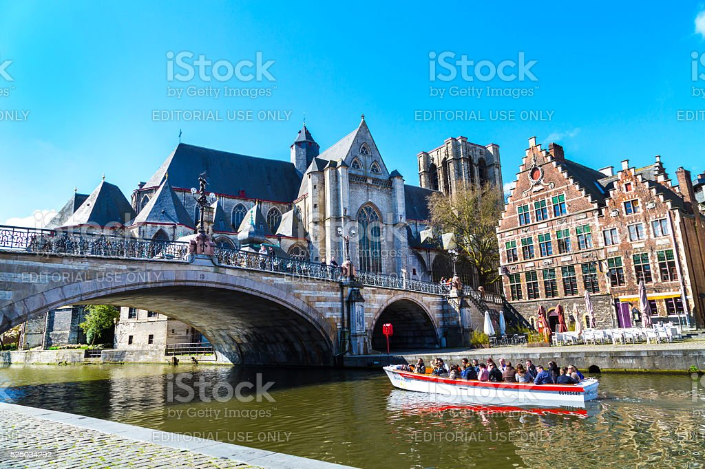 Medieval St. Michael Bridge, church and canal in Ghent, Belgium stock photo