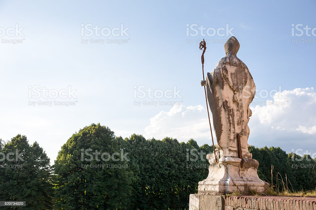 Medieval Statue of a Bishop Looking at Copy Space stock photo