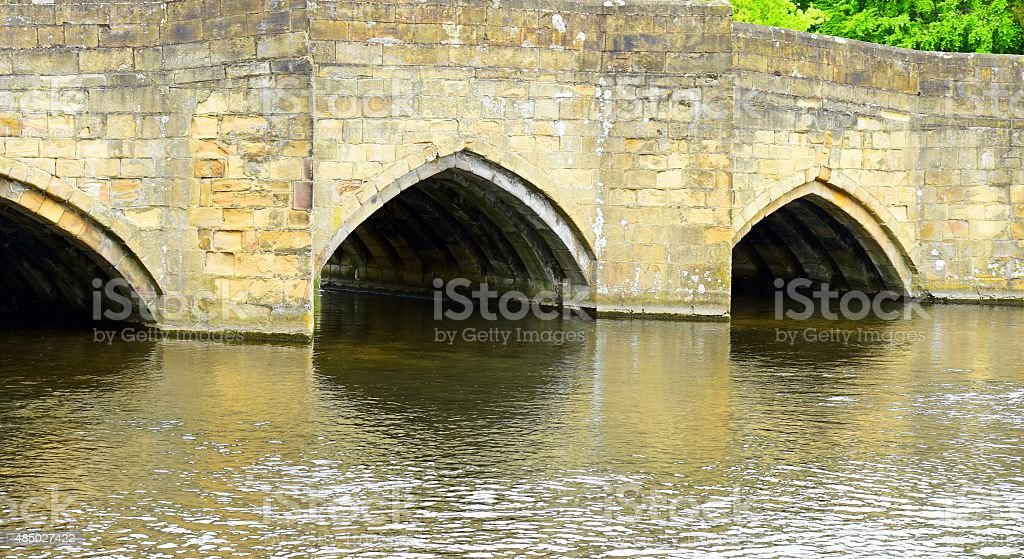 Medieval stone bridge in the small market town of Bakewell stock photo