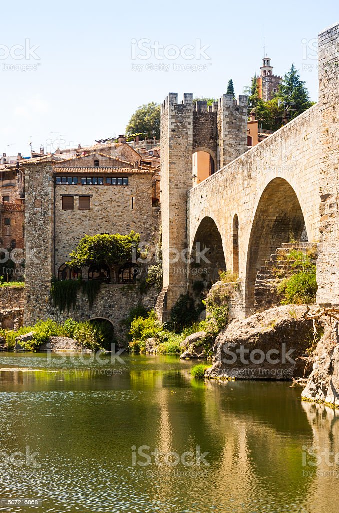 Medieval stone bridge wit gate stock photo