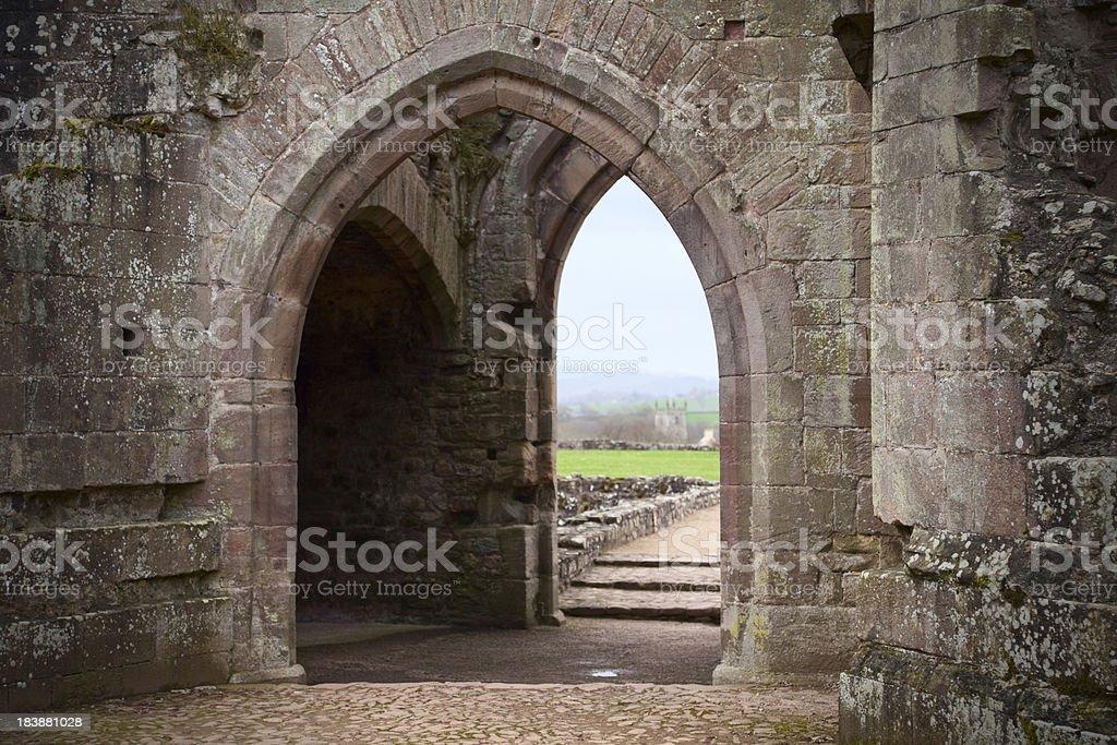 Medieval Stone Doorway at the Ruins of Raglan Castle, Wales stock photo
